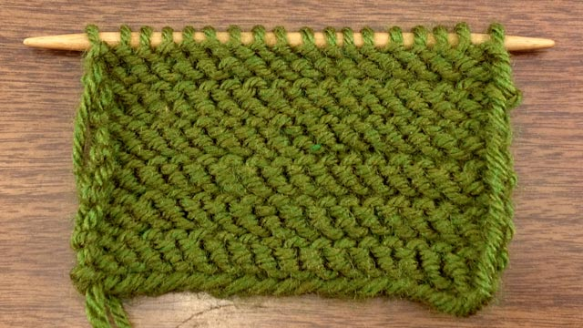 Example of the wrong side of stockinette with purl rows worked through the back loop